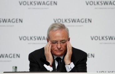 FILE PHOTO: Martin Winterkorn, chief executive officer of Volkswagen AG, reacts during an earnings news conference at the company's headquarters in Wolfsburg, Germany, on Monday, March 12, 2012. Volkswagen said 11 million vehicles were equipped with diesel engines at the center of a widening scandal over faked pollution controls that will cost the company at least 6.5 billion euros ($7.3 billion). Photographer: Michele Tantussi/Bloomberg *** Local Caption *** Martin Winterkorn